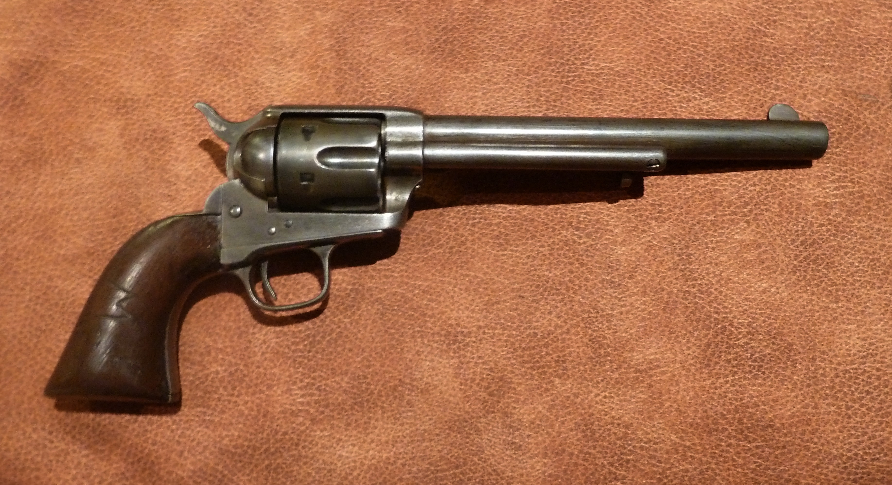 """singles in colt Single action army was what the military used when the guns were issued to the cavalry the factory even today uses model designations of the alphabet & this model was the """"p"""" calibers & configurations: the 45 colt chambering was by far the most popular, accounting for nearly half of the pre-wwii saa's."""