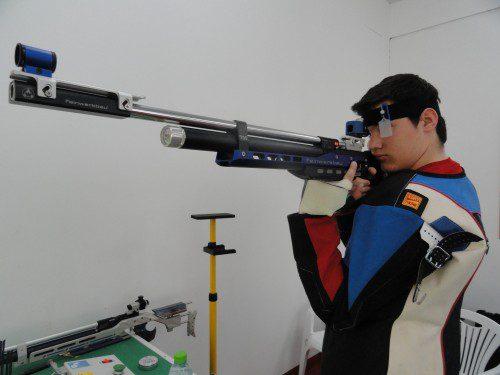 Tirador carabina tiro olímpico
