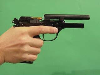 sistema por retroceso lineal del cañón pistola