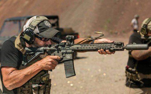 empuñar fusil posición alargada