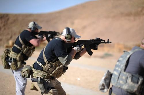 posición caderas tiro combate